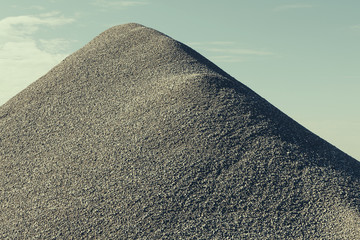 A large gravel pile, material used for construction and maintaining roads.
