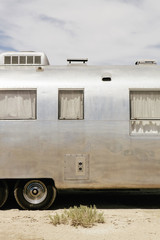 A vintage Airstream silver accommodation trailer parked on the Bonneville Salt Flats during Speed week.