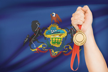 Medal in hand - Commonwealth of Pennsylvania.