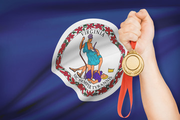 Medal in hand - Commonwealth of Virginia.