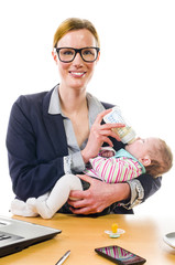 Happy businesswoman holding baby