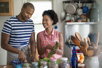 Lifestyle. Two people working in a farmhouse kitchen.