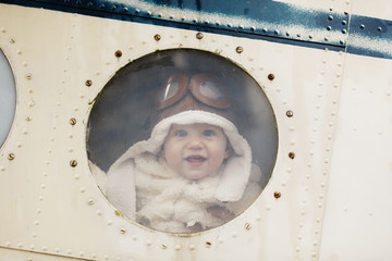 sweet little baby dreaming of being pilot