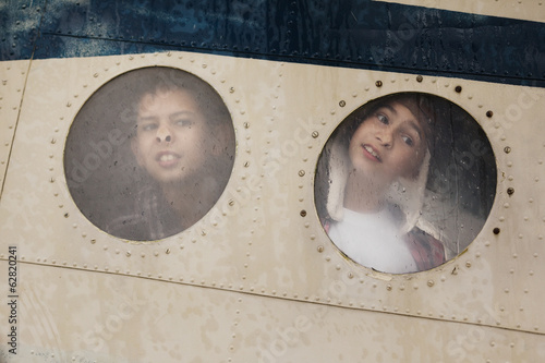 two funny boys in window of plane