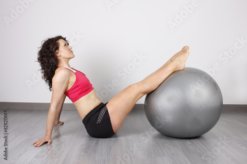 Woman stretching arms in the gymnasium
