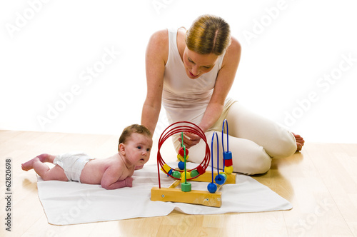 Mama playling with newborn baby