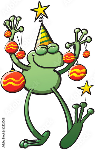 Green frog holding Christmas baubles and smiling