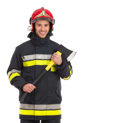 Firefighter posing with axe, Front view.