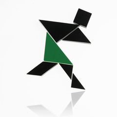 A number of triangles, squares and shapes arranged to represent a human being, in motion or action.