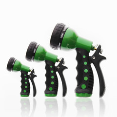 Three garden hose triggers and nozzles, in ascending size order.