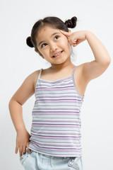 Happy little Asian girl thinking