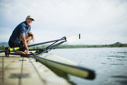A middle-aged man on a jetty preparing a rowing boat for an outing.