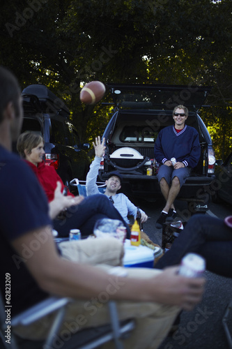 A group of friends at a barbeque or tailgate party at an event.