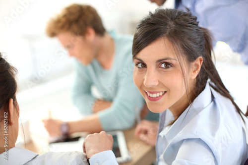 Smiling young businesswoman in business meeting