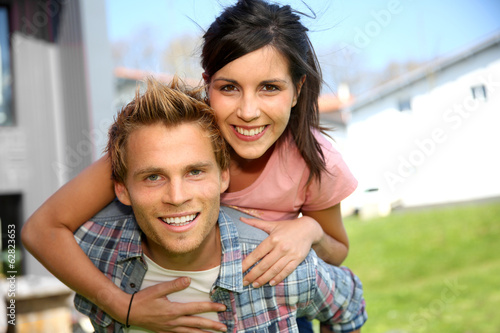 Young man giving piggyback ride to girlfriend