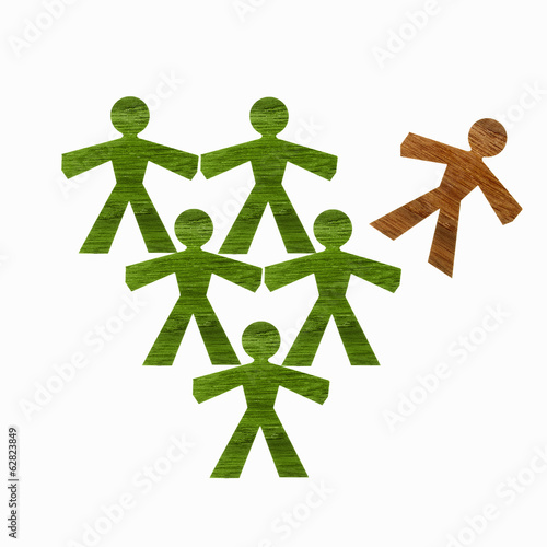 Papercuts, paper cut out figures representing people. Five green and one brown figure.