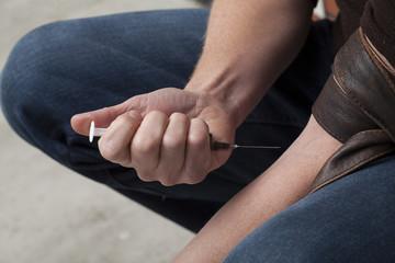 Shooting heroin closeup