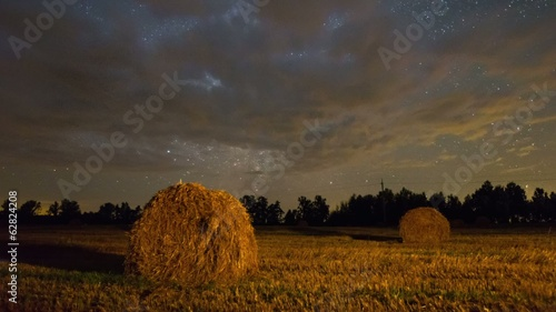 Autumn field with Milky Way under stars