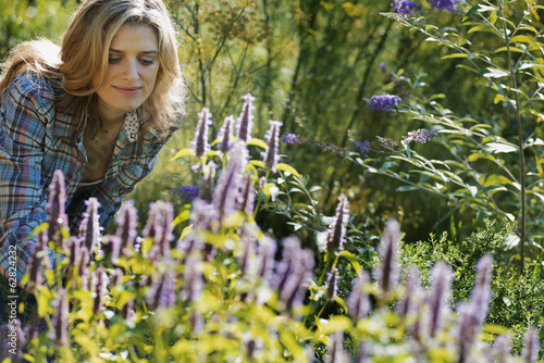 Woman tending a field of organic flowers at an organic flower nursery.