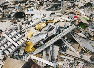 A heap of garbage and discarded items, building and domestic waste.