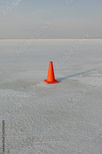 Traffic cone on salt flats, during Speed Week