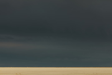 Storm clouds over Bonneville Salt Flats, dusk