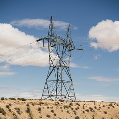 A tall pylon carrying power lines, in the desert near Tucson.