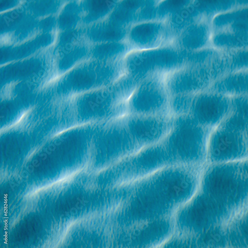 The moving water on the surface of a pool. Reflections and ripples catching the light.