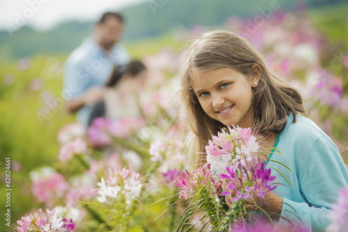 Three people among the flowers at an organic Flower Farm.