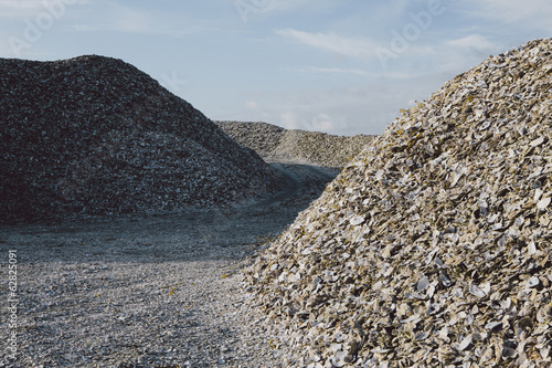 Road leading through piles of discarded oyster shells Oysterville USA