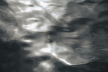 Close up of sunlight reflecting on moving water in Puget Sound, Washington, USA.