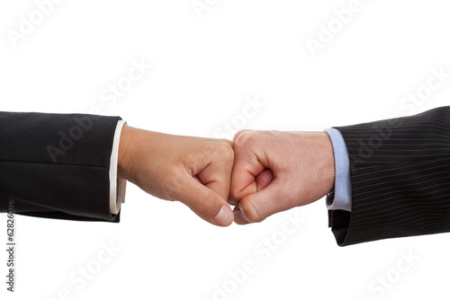 Fists of two people together