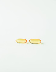Fish oil providing Omega-3, in softgel supplement capsules, a health supplement and fatty acid often recommended for health.