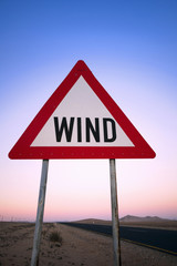 A wind warning sign by the roadside near the NamibRand Reserve in Namibia.
