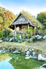 Wooden hut on pond  House of Tribes, Thailand