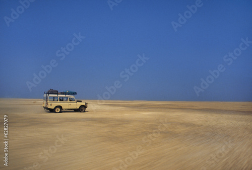 Vehicle moving across salt pans, Makgadikgadi Pans, Botswana