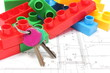 Home keys and colorful building blocks on housing plan