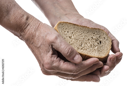old hand with bread