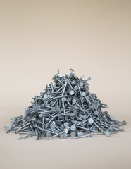 A heaped pile of galvanized nails.