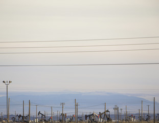 Oil rigs and power lines in the Midway-Sunset oil fields, the largest in California