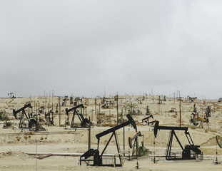 Oil rigs and wells in the Midway-Sunset shale oil fields, the largest in California