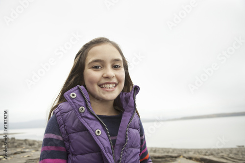 A day out at Ashokan lake. A young girl in a purple gilet.