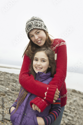 A day out at Ashokan lake. Two girls hugging and looking at the camera.