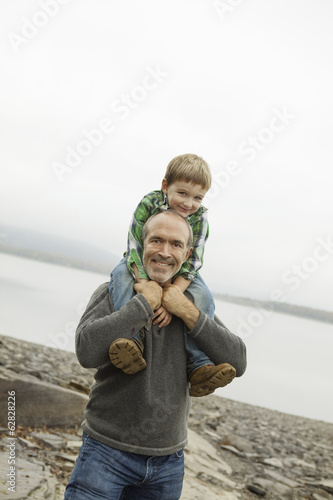 A day out at Ashokan lake. A man giving a child a shoulder ride.