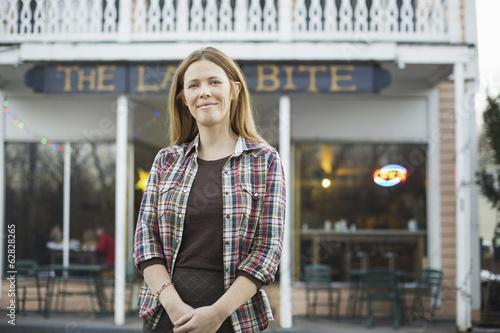 A coffee shop and cafe in High Falls called The Last Bite. A woman standing outside a high street cafe.