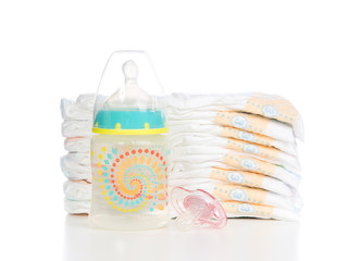 child stack of diapers, nipple soother baby feeding bottle with