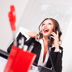 Attractive secretary talking on the phone