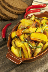 Potatoes baked in  oven with spices and rosemary