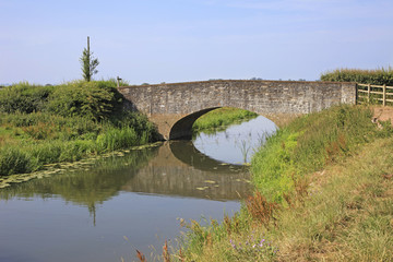 Slow moving River and Ancient Stone Bridge
