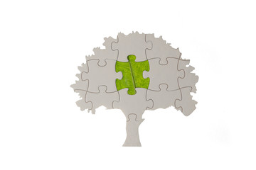 jigsaw puzzle tree with green leaf